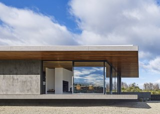 A Semi-Modular Beach House in Tasmania Floats Over a Site That Survived a Bushfire - Photo 3 of 9 - The living area floats atop a deeply recessed steel-reinforced concrete block structure. Styled by Julia Landgren