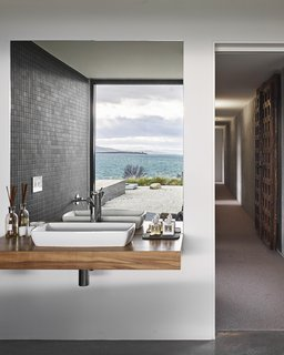 "A Semi-Modular Beach House in Tasmania Floats Over a Site That Survived a Bushfire - Photo 6 of 9 - ""The house is designed so that you can move around according to the weather and always find somewhere comfortable,"" says the architect. Styled by Julia Landgren"
