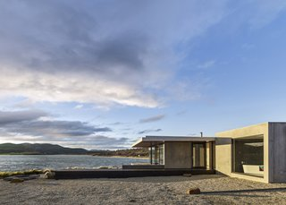 A Semi-Modular Beach House in Tasmania Floats Over a Site That Survived a Bushfire - Photo 8 of 9 - A long, narrow deck leads to a custom fire pit by the water's edge, a nod to the blaze that swept the property in 2013. Tanner worked with Cordwell Lane builders to complete the project in eight months. Styled by Julia Landgren
