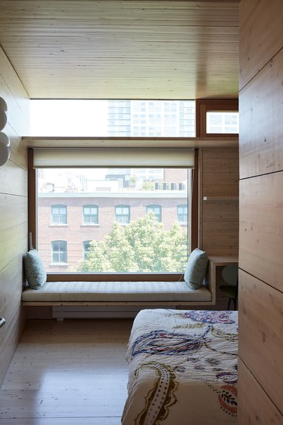 The partitions between the rooms and neighboring buildings are stud walls with board siding.