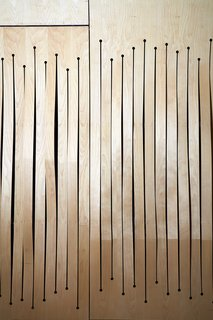 A 1905 Fire Station in Connecticut Is Converted Into a Community Hub For Art and Music - Photo 11 of 19 - A screen of milled bent birch plywood conceals acoustical panels. Like the undulating ceiling, the screen's wave-like design helps refract sound.