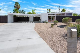 8 Midcentury-Modern Vacation Homes You Can Rent in Palm Springs - Photo 6 of 12 - With polished-concrete floors, post-and-beam ceilings, and an open floor plan, this Alexander home designed by William Krisel in the Racquet Club Estates has a home theater, a newly renovated kitchen, and a private backyard that offers spectacular mountain views. Plus, it's just minutes from downtown restaurants and bars.