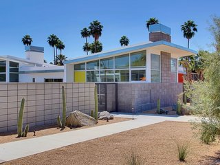 8 Midcentury-Modern Vacation Homes You Can Rent in Palm Springs - Photo 10 of 12 - Inspired by the rebellious 1960s, the swinging 1970s, and Hollywood glamour, this colorful, two-bedroom, two-bathroom condominium unit gives guests access to a shared pool, fire pit, and outdoor BBQ area.