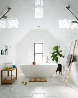 Dwell's Top 10 Bathrooms of 2017 - Photo 7 of 10 - For Kathryn and Josh Thole, Denver was the perfect catch. Josh, a professional baseball player now with the Arizona Diamondbacks organization, is on the road from mid February to mid October, leaving just four months a year for the family to spend time together at home. Denver, with its central location, sunny winters, and nearby mountain recreation, offered a place where the Tholes could make the most of the off-season.