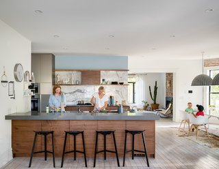 """Putting Down Roots in Denver, Ballplayer Josh Thole Renovates a 19th-Century Victorian - Photo 7 of 12 - """"The kitchen, dining area, and family room were originally three separate rooms,"""" says Wilding. <br>""""We opened the space by knocking down walls and installing two large flush beams in the ceiling."""" The original kitchen was located in what is now the family room."""