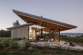 6 Modern Wineries on the West Coast With Beautiful Architecture - Photo 1 of 17 - Set at the top of the vineyard, the tasting room opens up to the valley with a structural wood-glazing system that provides guests with stunning panoramic views.