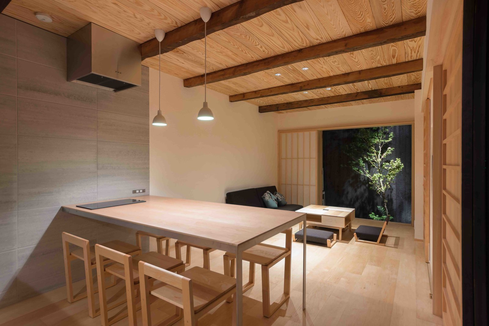 Tagged: Dining, Table, Stools, Pendant, Recessed, and Light Hardwood.  Best Dining Pendant Stools Photos from Stay in a Historic Japanese Townhouse in Kyoto That Was Saved From Ruin
