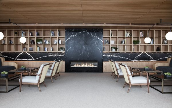 The hotel's interiors emphasizes the use of natural materials such as stone, wood, and linen.