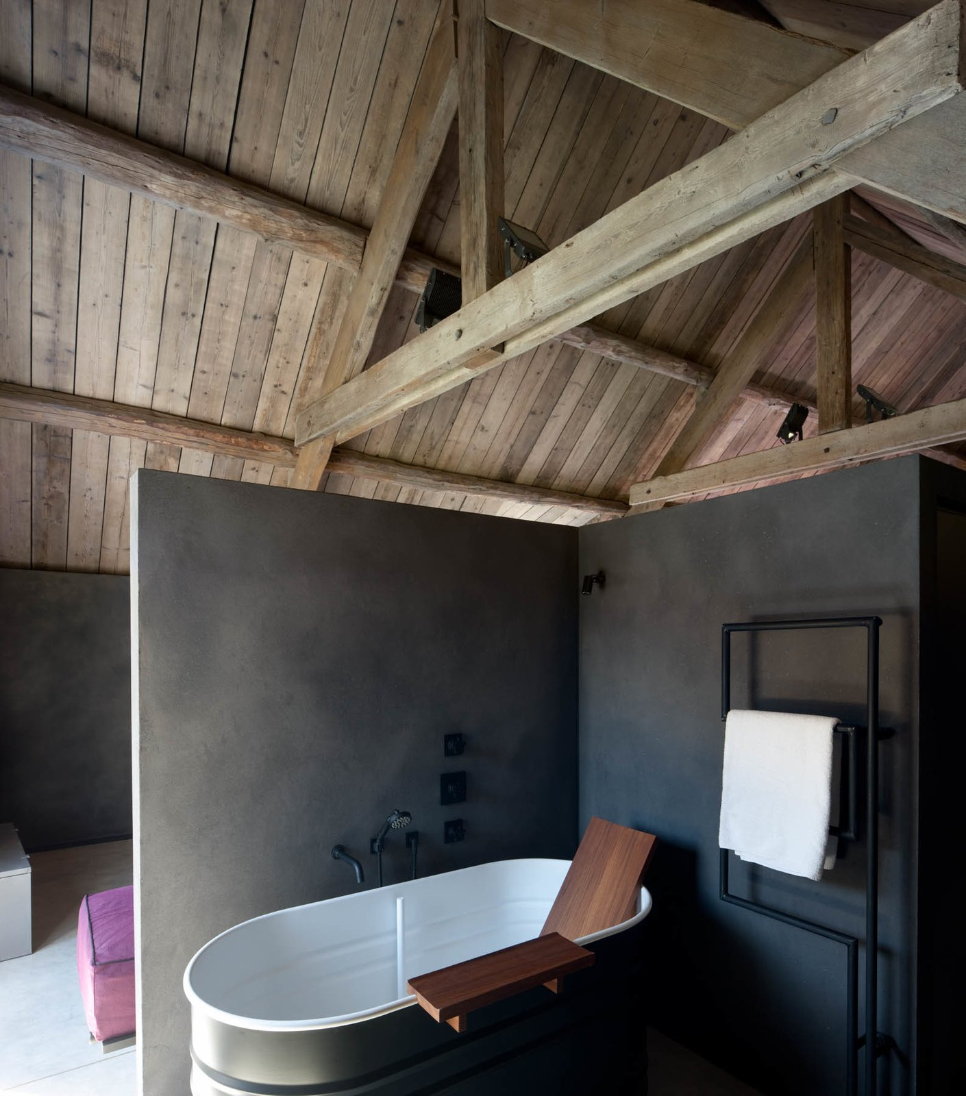 Each room comes equipped with an en suite bathroom. This one includes a stylish bathtub by Agape. Tagged: Bath Room, Freestanding Tub, and Concrete Floor.  Photo 10 of 16 in Stay at an Old Converted Train Station in the Belgian Countryside