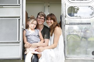 Airstream Dream Team: These Women Travel the Country, Turning Retro RVs Into Homes - Photo 3 of 14 - Ellen Prasse, Kate Oliver, and their daughter, Adelaide, in the doorway of a renovated Airstream.