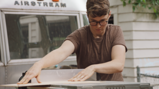 Airstream Dream Team: These Women Travel the Country, Turning Retro RVs Into Homes - Photo 4 of 14 - Ellen Prasse works with a table saw outside the Airstream she and Oliver are renovating.