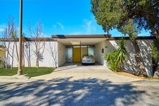 A Midcentury-Modern Home in L.A. Designed by Richard Banta Is For Sale For $899K - Photo 1 of 13 - This Richard Banta-designed midcentury home is located at 1031 Berlin Drive in Glendale, California. The two-bedroom, two-bath house measures 1,218 square feet and sits on a 3,030-square-foot lot.