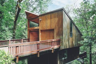 This Tree House For Rent Near Downtown Portland Doubles As an Art Platform - Photo 1 of 14 - Though the tree house-inspired home is nestled in the middle of a dense forest, it's still only 10 minutes away from downtown Portland.