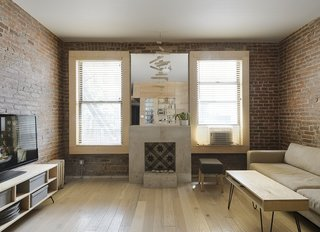 This Compact Apartment in NYC Is Full of Crafty Solutions - Photo 1 of 18 - Peter Kostelov, an accredited architect in Russia who is studying for his U.S. license, gutted the 700-square-foot apartment and reapportioned rooms. The living/dining room is located on the east side of the residence, to capture all available natural light.