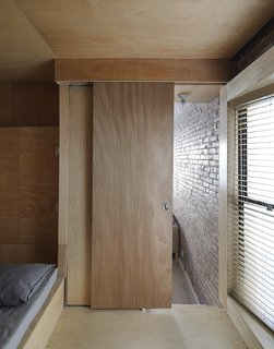 This Compact Apartment in NYC Is Full of Crafty Solutions - Photo 8 of 18 - The bedroom/office is a few steps above the living/dining room.