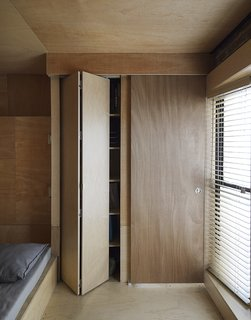 """This Compact Apartment in NYC Is Full of Crafty Solutions - Photo 12 of 18 - Storage strategy is key in small spaces, and Peter took extra care in this regard. """"We like to go camping, and Olia has canvases and other art equipment,"""" he says."""