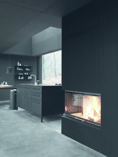 A Vipp kitchen and fireplace offer an upscale dining experience, even in the wilderness.