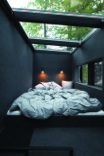 An Experimental New Hotel Includes a Steel Prefab and a Copenhagen Loft - Photo 3 of 9 - The sleeping area features skylights that allow for stargazing at night.