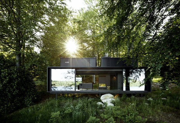 At 55 square meters, the Vipp shelter is a steel prefab whose glass doors slide open to immerse guests in nature.