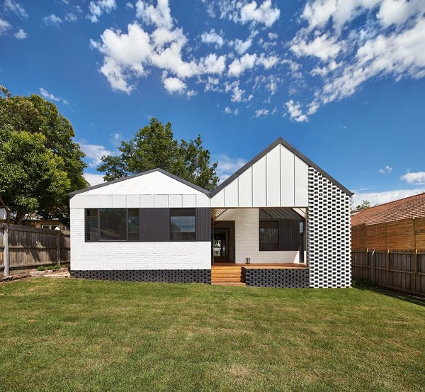 The 2,691-square-foot home was given an entire new roof and facade at the rear.