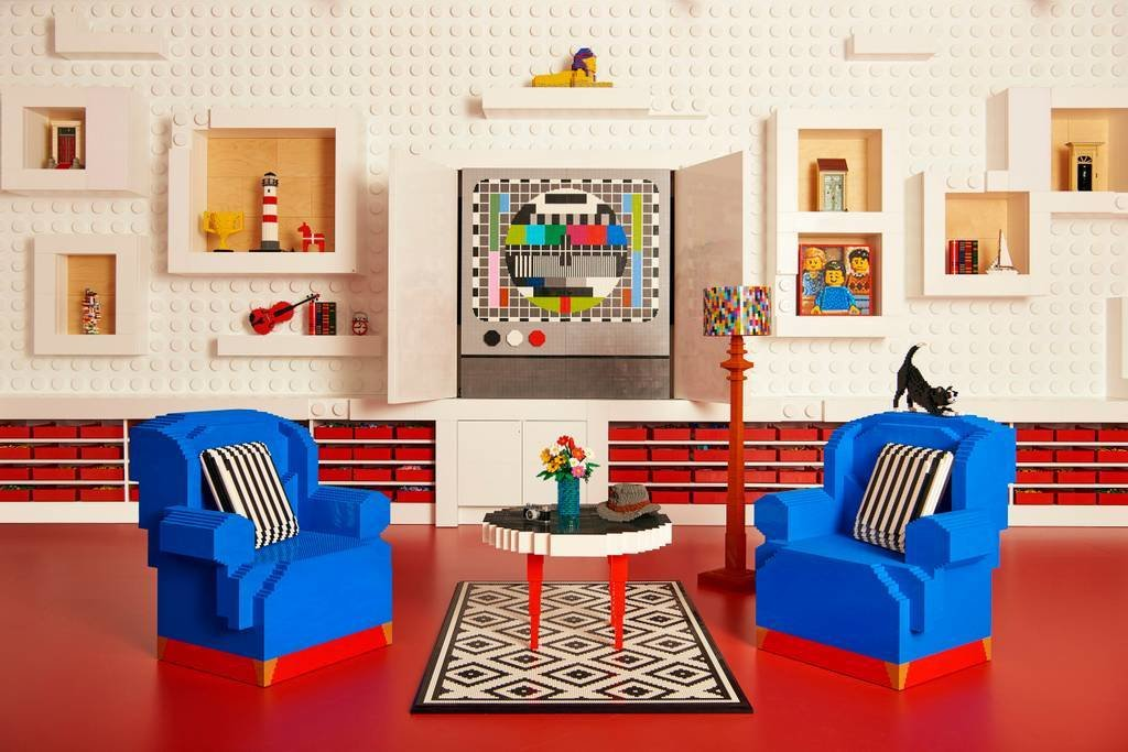 Tagged: Living Room, Chair, Coffee Tables, Floor Lighting, Lamps, and Rug Floor.  Photo 6 of 10 in Spend an Unforgettable Night in Denmark's New LEGO House