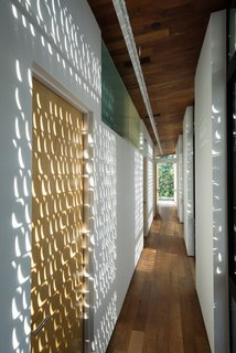 Besides Being Works of Art, These Custom Metal Shutters Master the Texas Heat - Photo 4 of 7 - Light passing through the perforated shutters animates the upstairs.