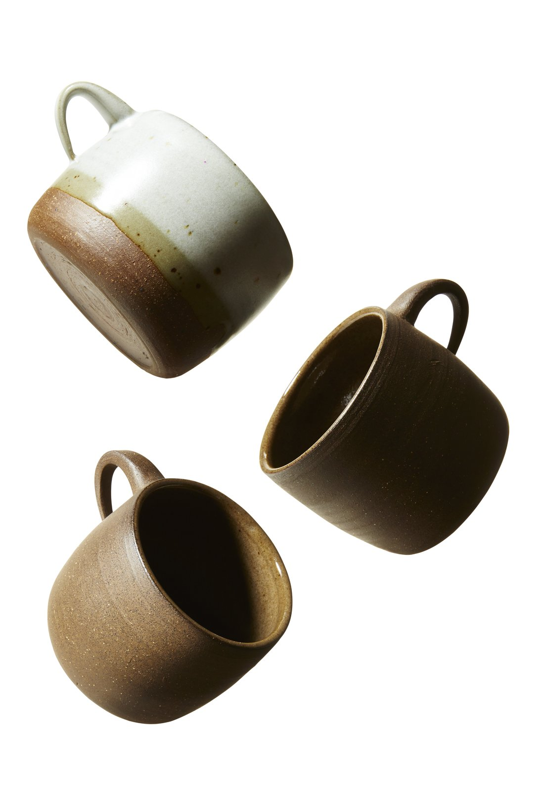 """Stoneware Mugs (2016) CGCERAMICS Christie Goodfellow, Owner """"The mugs are produced in  a 169-square-foot studio in my backyard. Each one takes about 38 minutes—this includes casting, cleaning up and preparing the piece to be fired, bisque firing, glazing, and glaze firing. Typically two people are involved in the production process; I usually cast the pieces and my studio assistant cleans up the parting lines  and prepares the pieces for firing."""""""