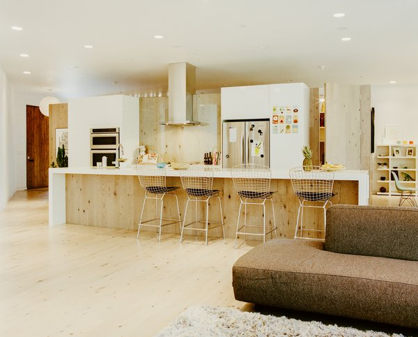 In the kitchen, Structube stools pull up to a Quartzforms countertop.