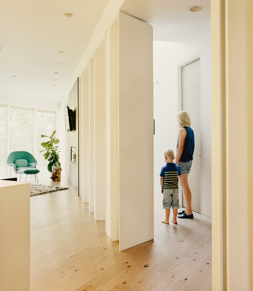 Maple columns painted Benjamin Moore Ultra White mirror the steel pillars found outside.