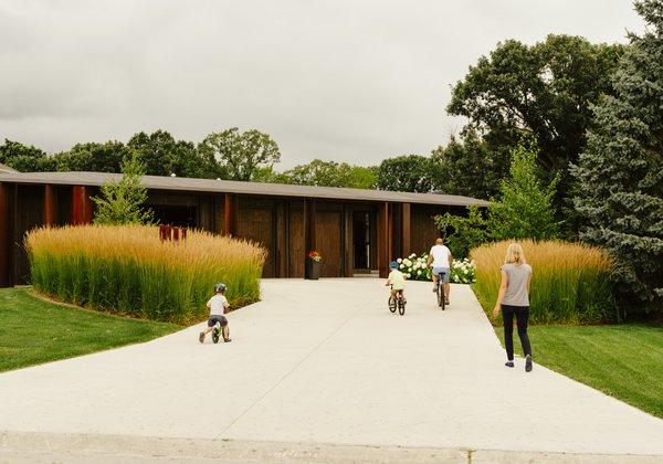 In front, landscape architects Scatliff + Miller + Murray planted tall grasses on either side of the driveway to establish a prairie-like environment.