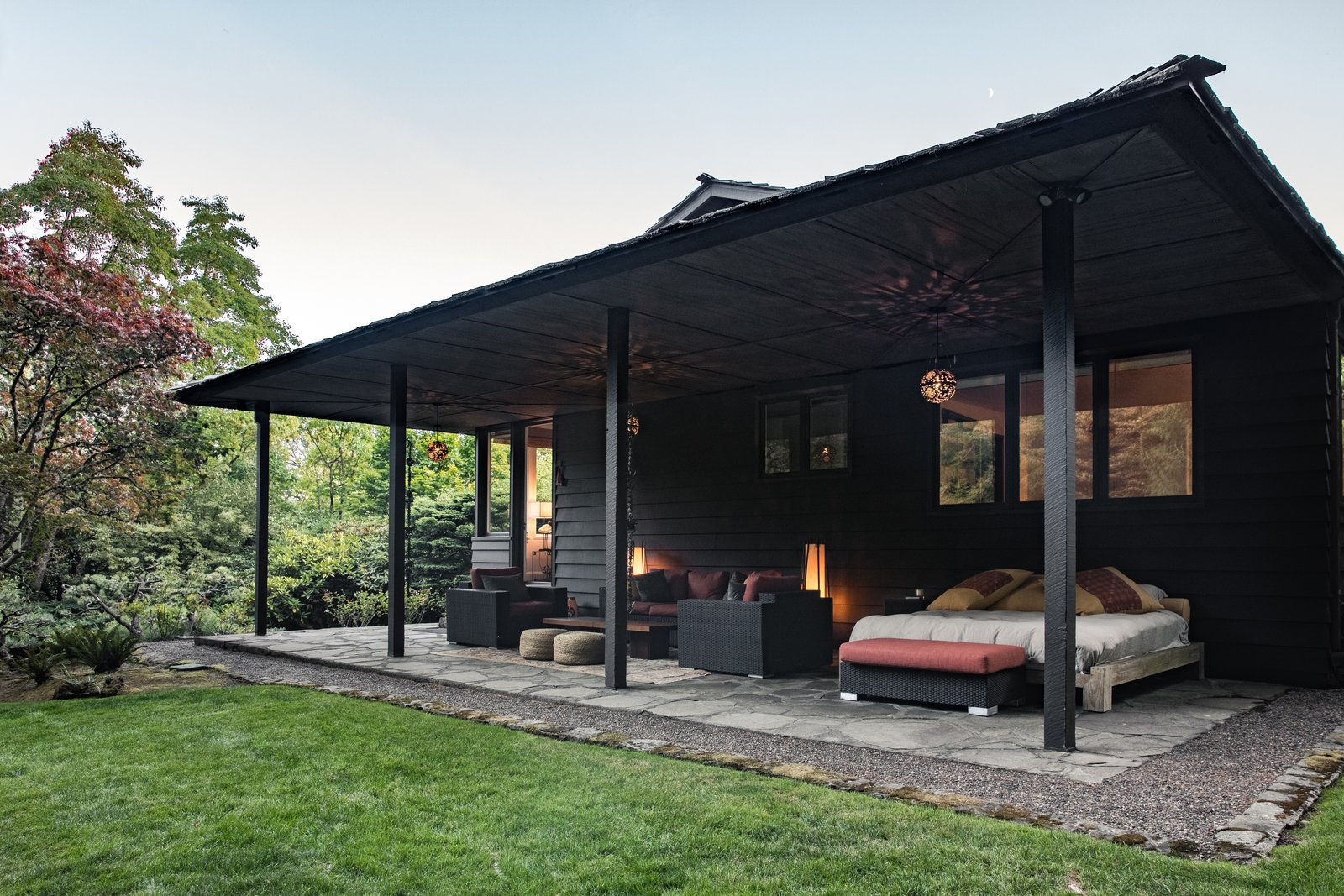 The portico is used as a living room in Spring and Summer. Tagged: Outdoor, Pavers Patio, Porch, Deck, Grass, Trees, and Hardscapes.  Photo 12 of 15 in Nearly 80 Years Later, an Architect Rescues a Japanese-Inspired  Masterwork Designed by His Father