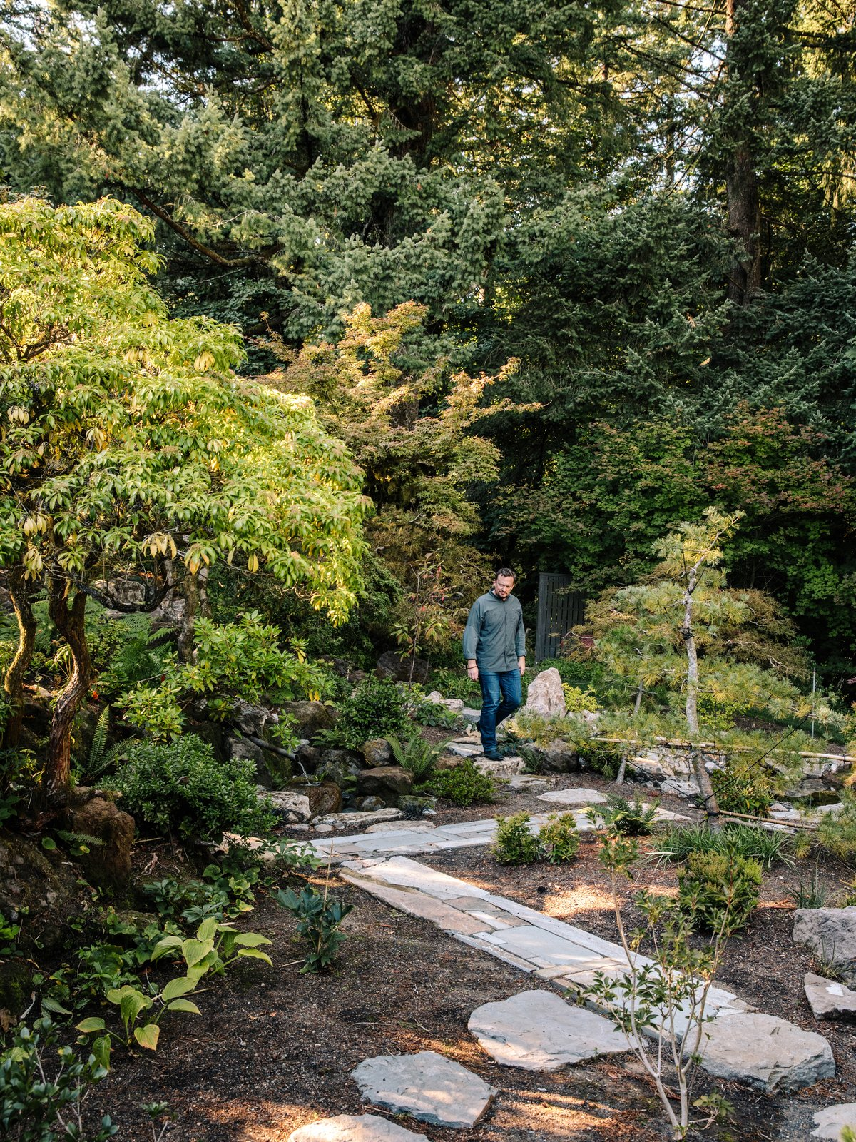 Uncovered paths lead straight down into the forest. Tagged: Outdoor, Walkways, Gardens, Garden, Trees, Shrubs, Hardscapes, and Boulders.  Photo 14 of 15 in Nearly 80 Years Later, an Architect Rescues a Japanese-Inspired  Masterwork Designed by His Father