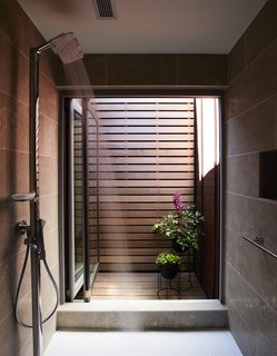 On the Coast of Massachusetts, a Prefab Ranch Is Totally Overhauled for a Wheelchair-User - Photo 5 of 11 - A courtyard off the master bath acts as a solar chimney, drawing in cool air and bringing light and ventilation into the shower. The fixture is from Hansgrohe.