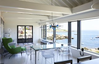 On the Coast of Massachusetts, a Prefab Ranch Is Totally Overhauled for a Wheelchair-User - Photo 8 of 11 - Reached by stairs as well as an elevator, the first floor holds the main living spaces, bathrooms, and bedrooms. The Havana wing chair is by Busk + Hertzog for Softline and the Comback rocking chairs by Patricia Urquiola for Kartell are from YLiving.