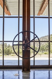 "At This High-Desert Home, a Whole Wall Opens Up When You Crank a Giant Wheel - Photo 5 of 10 - A gearbox from an old irrigation pump helps turn the wheel that opens the window wall, a detail that reflects Kundig's love of simple yet sophisticated ""contraptions."""