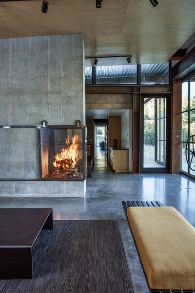 Inspired by Russian and Finnish designs, the fireplace harvests hot air by sending it into the basement and radiating it into the room. - Tehachapi Mountains, California Dwell Magazine : November / December 2017