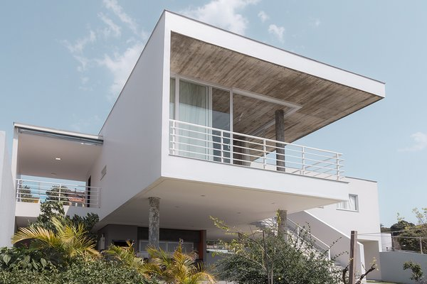 In southern Brazil, a 3,390-square-foot house designed by Barbara Becker and built by Charrua Construções perches on a slope overlooking the city of Pato Branco. - Pato Branco, Brazil Dwell Magazine : November / December 2017