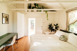 This 120-Year-Old Home With a Greenhouse Is a Gardener's Paradise - Photo 25 of 27 - The guest suite, often rented out to visitors and tourists, also incorporates plants and greenery.