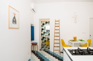 An Old Fisherman's House in Sicily Is Transformed Into 2 Apartments - Photo 1 of 12 - The now combined kitchen and dining space in the one-bedroom apartment is compact yet efficient.