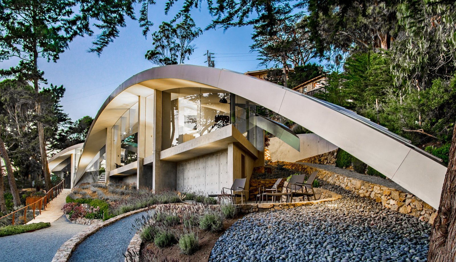 Tagged: Exterior, Beach House Building Type, House, Metal Roof Material, Concrete Siding Material, and Curved RoofLine.  Best Photos from We Wish We Had $11.4M to Buy This Oceanfront Wonder in Carmel