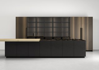 Watch Out For These Two Kitchen and Bath Trends in 2018 - Photo 10 of 32 - K21 kitchen by Boffi</p><p>Prices upon request Norbert Wangen's K21 kitchen system for Milan-based Boffi, introduced in 2017, offers extruded aluminum handles in an anodized matte-black finish and upper cabinets in dark wood and PaperStone black Slate.