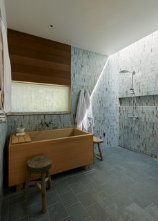 You'd Never Guess This Japanese-Style Home in Tiburon Is a Kit House - Photo 6 of 12 - In the master bath, Hale chose slate tile for the floors and green-and-brown glass tile by Lunada Bay for the walls, both from United Tile. The Japanese Ofuro soaking tub, crafted from Hinoki wood, is by Zen Bathworks.