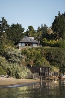 You'd Never Guess This Japanese-Style Home in Tiburon Is a Kit House - Photo 10 of 12 - The property, situated on a steep bluff overlooking the San Francisco Bay, includes a main house with a deck, a pool, an outdoor kitchen, and a boathouse.