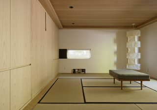 You'd Never Guess This Japanese-Style Home in Tiburon Is a Kit House - Photo 9 of 12 - The new interior includes a meditation room with an Isamu Noguchi lamp, flooring made of tatami mats, and a Murphy bed for visitors.