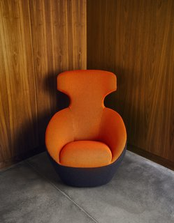 A Curved House in Ontario Bends 100 Degrees For Forest Views - Photo 4 of 16 - The Edito chair in the den is by Sasha Lakic.