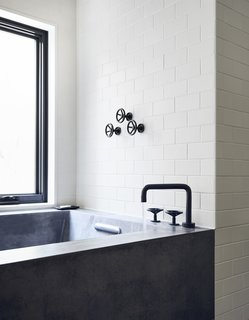 A Curved House in Ontario Bends 100 Degrees For Forest Views - Photo 8 of 16 - All of the home's plumbing fixtures are from Watermark Designs' Brooklyn 31 collection.