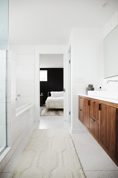 The master bathroom features Terrazzo tile from Terrazzio  and American walnut cabinetry.