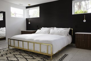 Midcentury Mashup: A 1950s Ranch House in Chicago Gets a Palm Springs-Style Butterfly Roof - Photo 11 of 15 - An Alchemy bed from CB2 is flanked by marble-topped night stands. The Krisztian Mecs for Intueri Light pendants are from Lumens.