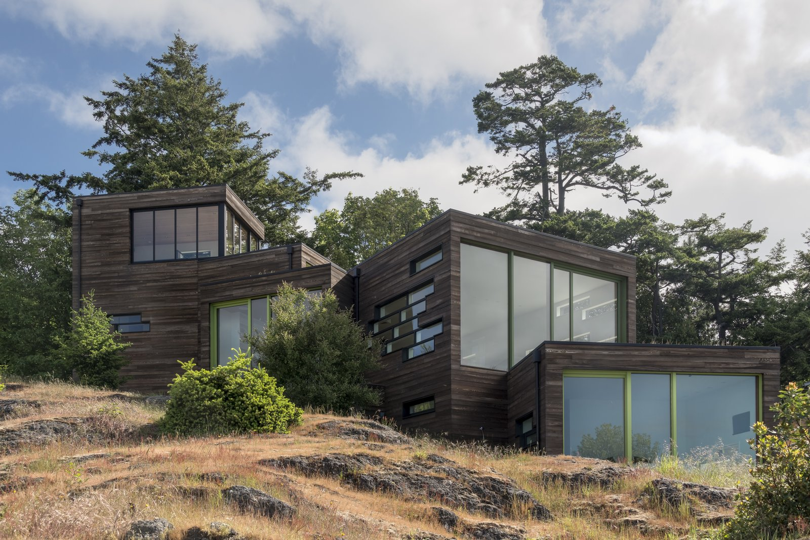 Bonnie and Paul Bunning's 3,600-square-foot home is composed of four stacked volumes covered in cedar and cypress