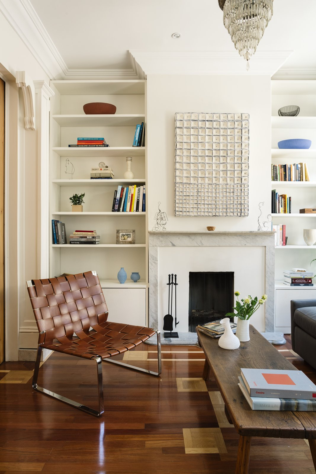 The mixed-wood floor includes cherry with maple parquet. The Pol chair is by Mark Albrecht Studio.